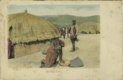 WPAC-1125892 - Woman with baby grinding corn