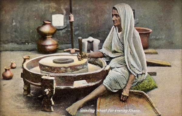 Using a quern or handstone, India 1909 (Postcard from the Mills Archive Collection, MCFC-10529)