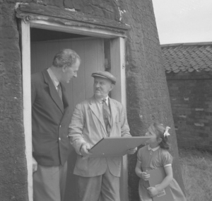 Rex presenting an SPAB Windmill Certificate to George Foster, miller of Subscription Tower Mill, North Leverton, Nottinghamshire, August 1954.