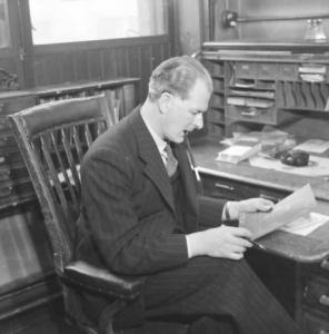 Rex in his office at George Wailes and Co., Euston Road, London, c1950.