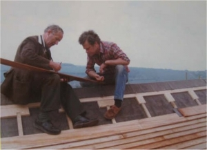 Frank Gregory and Peter Casebow discuss the fitting of the final boards to the ridge of the roof of High Salvington Mill